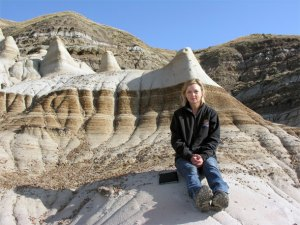 Darla Zelenitsky in Alberta badlands where the feathered dinosaurs were found.