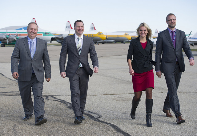 Municipal Affairs Minister Deron Bilous, Red Deer County Mayor Jim Wood (far left), City of Red Deer Mayor Tara Veer and R.J. Steenstra (CEO of Red Deer Regional Airport Authority) check out the aircraft on display after Tuesday's announcement.