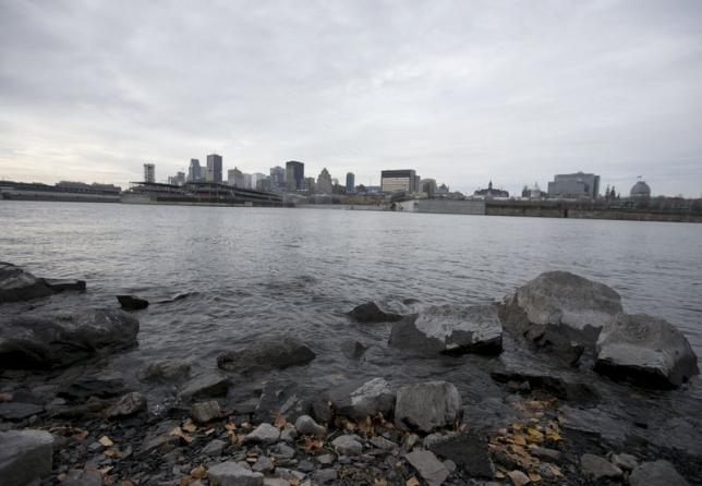 The shore of the St. Lawrence river showing the city and the Old Port is seen in Montreal November 11, 2015. REUTERS/Christinne Muschi