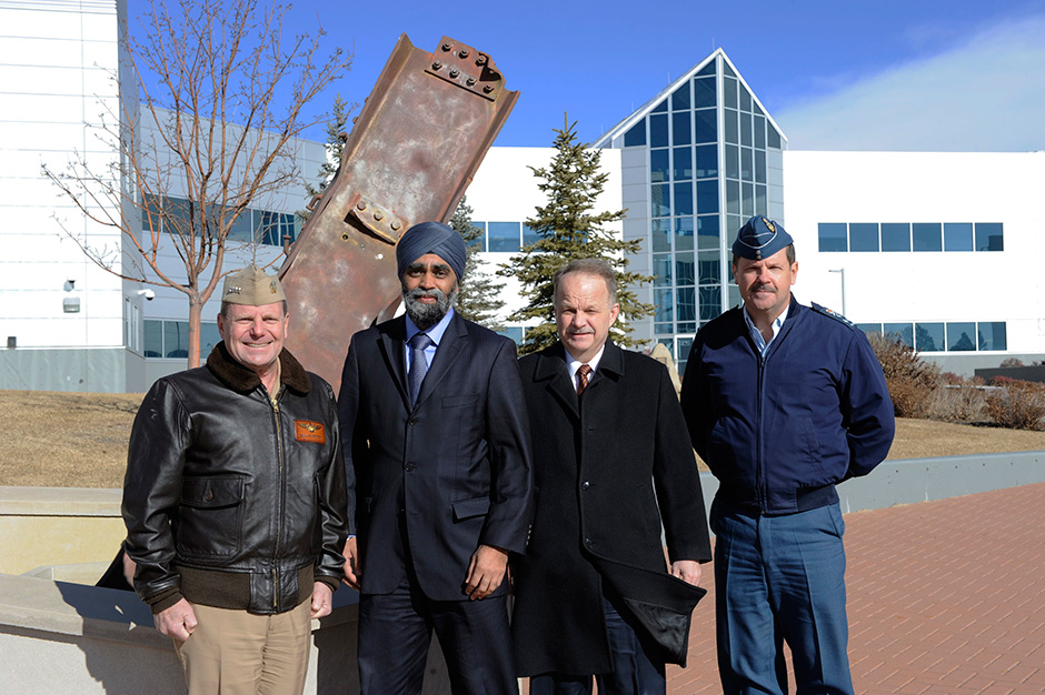 Admiral Bill Gortney, Commander of the North American Aerospace Defence Command (NORAD) and U.S. Northern Command (USNORTHCOM), together with, Defence Minister Harjit S. Sajjan, John Forster, Deputy Minister of National Defence, and Canadian Lieutenant-General Pierre St-Amand, Deputy Commander of NORAD, pose for a photo in front of the 9/11 memorial at NORAD headquarters in Colorado on January 20, 2016.