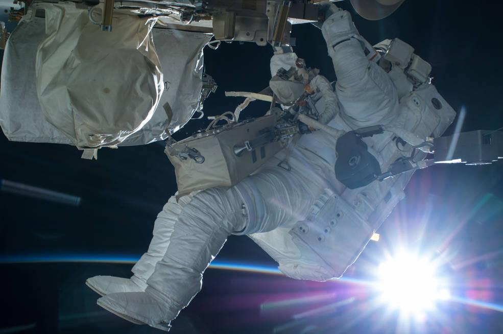 Astronaut Terry Virts conducts a spacewalk during an orbital sunrise on Feb. 21, 2015. Credits: NASA