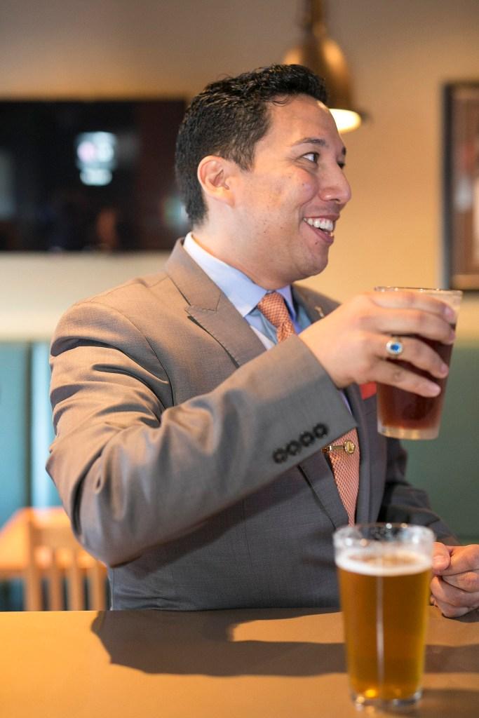 Minister Ricardo Miranda enjoying a sample of Olds College Beer!