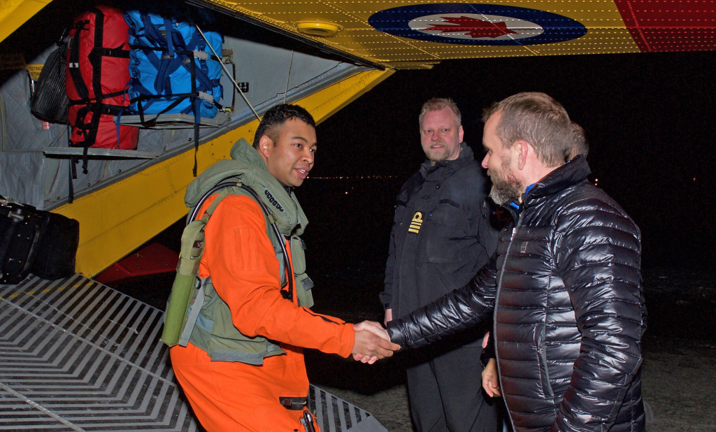 Lieutenant-Commander Thorben Lund (right) greets Captain Pete Wright (left) at the Reykjavik airport on February 8, 2016. PHOTO: Master-Corporal Johanie Maheu