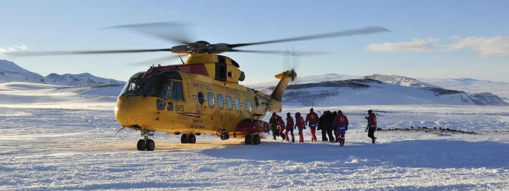 Members from the Iceland Association for Search and Rescue (ICE-SAR) walk towards a CH149 Cormorant aircraft from 103 Squadron Gander, NL on Langjokull glacier during a Joint SAR Exercise held in Iceland on 10 February 2016.  Photo By: Master Corporal Johanie Maheu, 14 Wing Imaging Greenwood  GD2016-0075-16