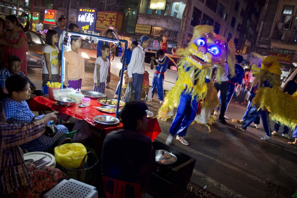 Men perform a dragon dance in Latha township, Yangon's Chinatown district on February 7, 2016 on the eve of the Lunar New Year which marks the start of the year of the monkey. (Getty)