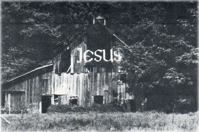 The infamous (and now gone) Jesus barn on Vashon Island, Washington, formerly on the property in question. Historic photo.