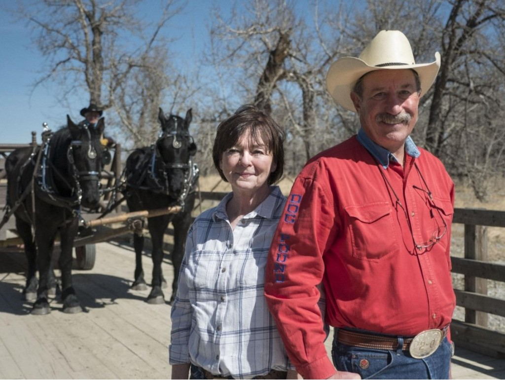 Lois and Jim Barbaro at the Bar U Ranch National Historic Site with the new team of Percheron horses. Jim received an Annual Discovery Pass for his winning name submission. Bar U Ranch heritage presenter Ross Fritz is seen in the background with Terra (L) and Poca (R). Come meet the team when the site opens on May 16. ©Parks Canada