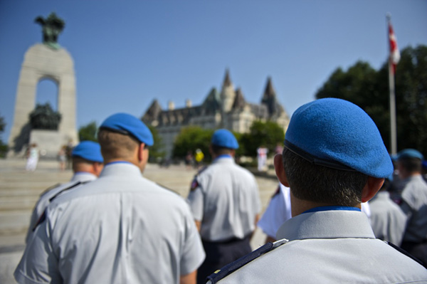 Police officers gather at the National War Memorial in Ottawa for the National Peacekeepers' Day parade to the National Peacekeeping Monument.