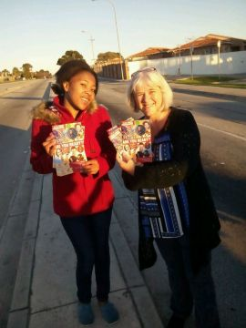 YWAM team handing out Switched On flyers