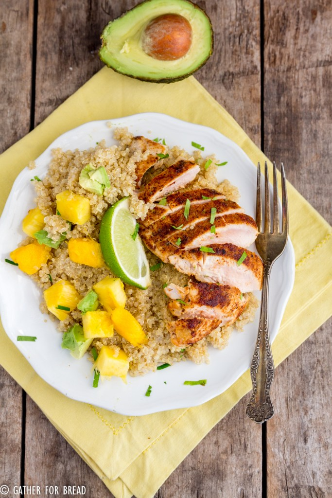 Main dish with quinoa, blackened chicken topped with pineapple, mango and avocado makes a healthy nutritious meal!