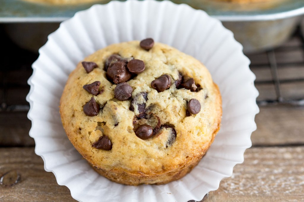 Banana Chocolate Chip muffins - Bakery style Homemade muffins. Perfect for breakfast or snack. These are a family FAVORITE!