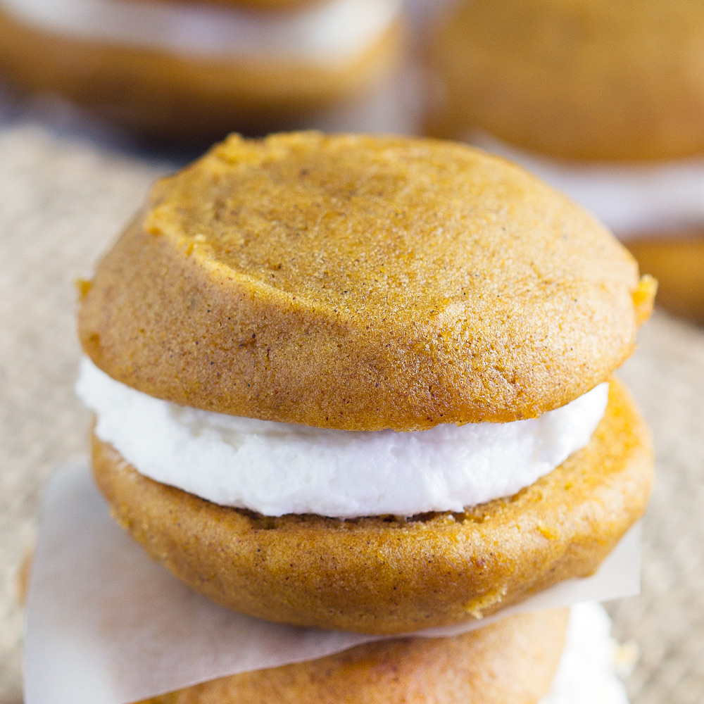 Pumpkin Whoopie Pies - Homemade Amish pumpkin whoopie pies perfect for autumn. Sandwich cookies are soft and perfect for sharing for bake sales and more. Our favorite fall treat!