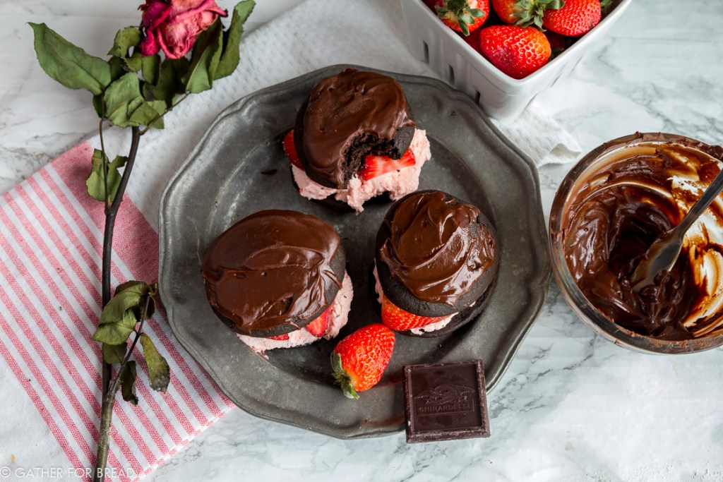 Chocolate Covered Strawberry Whoopie Pies - Chocolate cookies stuffed with fresh strawberry filling, and a chocolate ganache. Like chocolate covered strawberries and a cookie all in one! Perfect to share with your love on Valentine's or any day of the year!