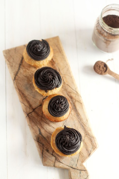Banana Cupcakes with Dark chocolate frosting. These super soft cupcakes have the best flavor of banana and rich dark chocolate. Amazing!
