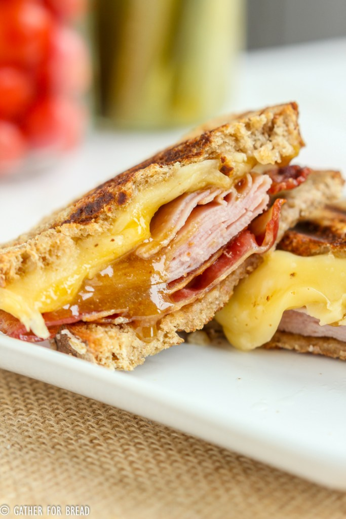 Bacon Ham Grilled Cheese Brown Sugar Mustard Sauce - Delicious gooey grilled cheese sandwiches stuffed with bacon, ham and cheese. Grilled with a warm brown sugar mustard sauce.