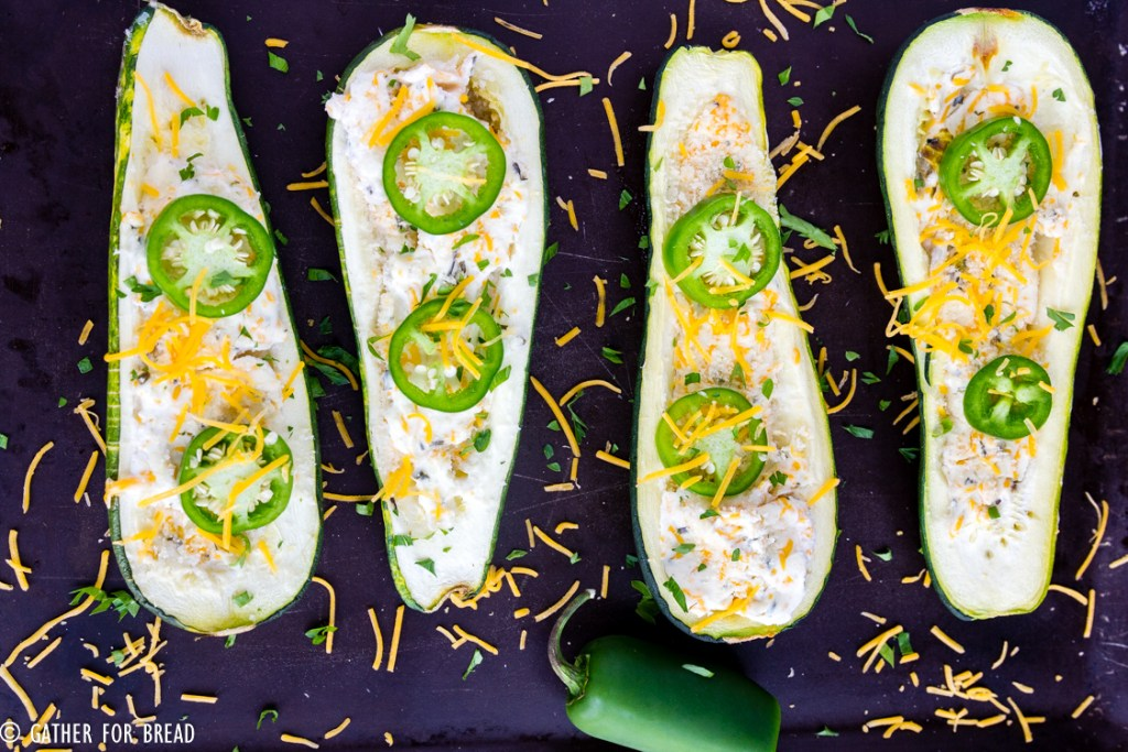 Jalapeno Popper Zucchini Boats - A fresh twist on traditional zucchini boats. They're loaded with cheese, jalapeno and have just the right pop. Perfect summer side dish.
