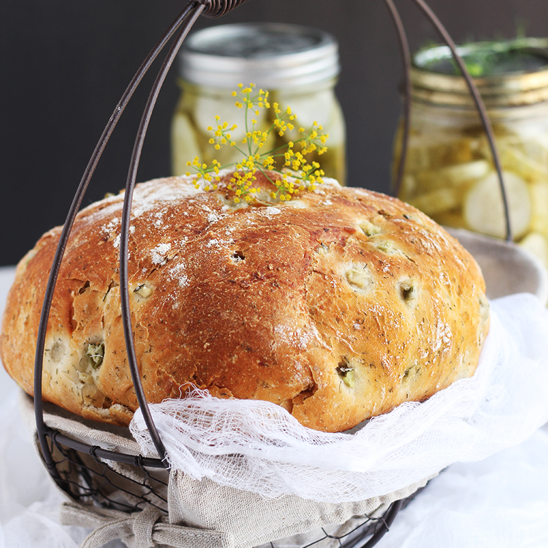 Dill Pickle Bread – Delicious yeast bread with the full flavor of dill pickle. This bread makes the perfect addition to any summer meal or picnic. Wonderful served alongside hot dogs or hamburgers.