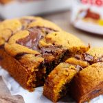Nutella Swirled Pumpkin Bread - Moist pumpkin bread swirled with a delicious flavor of Nutella. Chocolate and pumpkin pair up perfectly in these fall loaves. A favorite autumn quick bread.