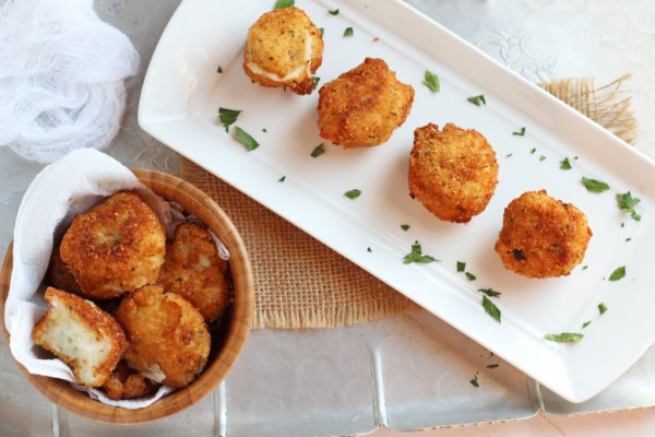 Fried Mashed Potato Balls -- PFried Mashed Potato Balls -- Perfect use for leftover mashed potatoes. Crunchy outside, creamy inside | gatherforbread.com
