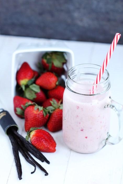 Strawberry Vanilla Smoothie - Creamy blend of yogurt, milk, frozen strawberries and a dash of vanilla. Delicious recipe for breakfast or snack. 5 ingredients. 5 minutes.