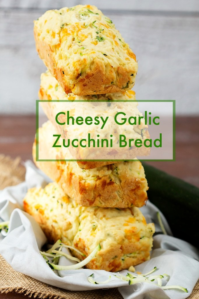 Delicious homemade fresh zucchini bread with cheddar cheese and garlic. Simple tasty recipe is the perfect summer appetizer or side to every meal.
