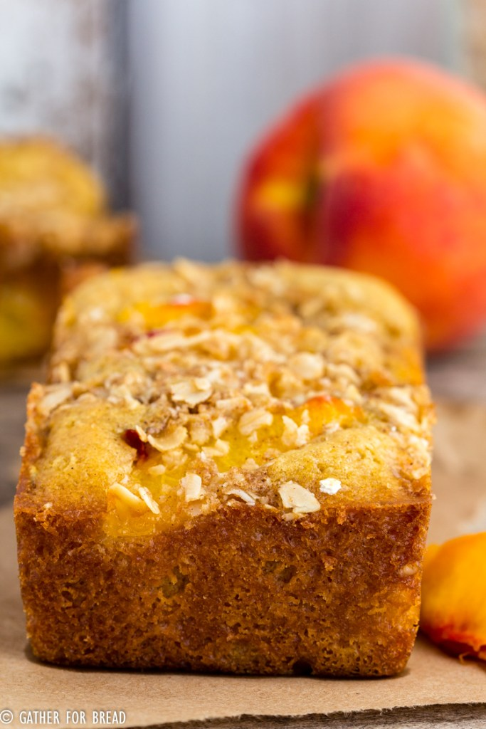 Peach Streusel Quick Bread - Homemade quick bread made with fresh peaches and topped with a crunchy oat streusel. Sweet loaf that's perfect for summer!