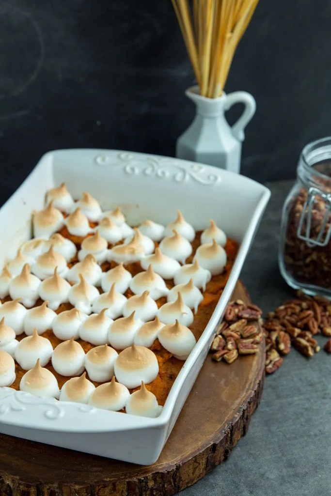 Sweet potato casserole baked with simple ingredients like pure maple syrup. Topped with homemade marshmallow meringue for a perfect Thanksgiving side dish. // gatherforbread.com