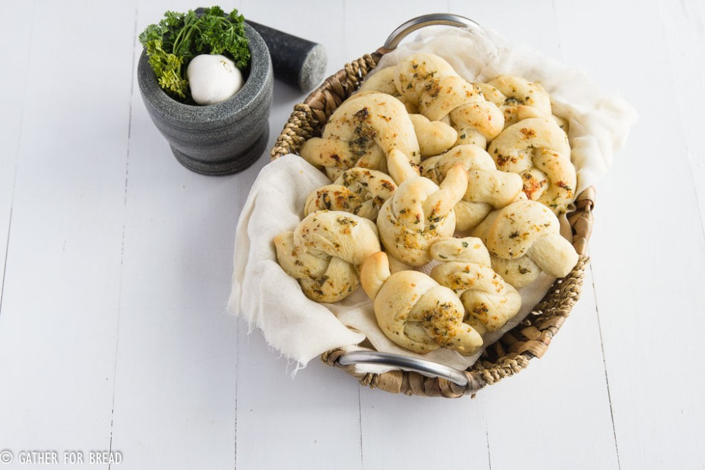 Homemade Garlic Parmesan Knots - Soft, knots topped with Fresh Parmesan, butter and garlic. | gatherforbread.com