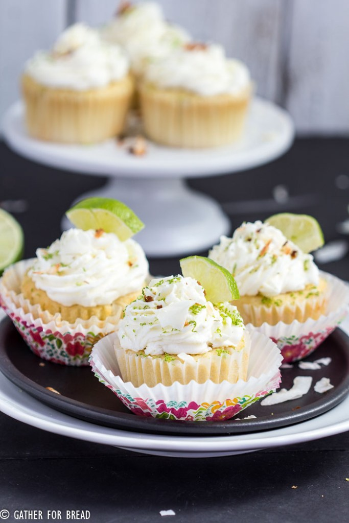 Coconut Lime Cupcakes - Fluffy, delicious cupcakes with hints of lime and sweet coconut. | gatherforbread.com