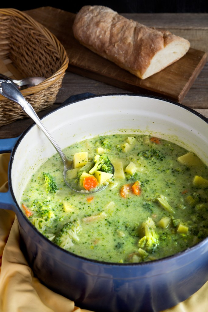 Broccoli Potato Cheese Soup - Cheesy broccoli soup recipe has broccoli flowerets, potatoes, sharp cheddar cheese and vegetables for a comforting bowl of yum.