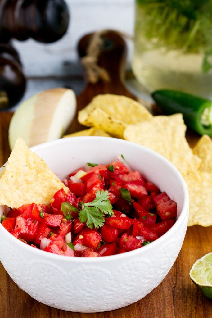 Fresh Homemade Tomato Salsa - Fresh tomatoes combine with onion, jalapeno, cilantro and seasonings for a perfect homemade Mexican flavor. Great summer starter or appetizer recipe for any meal or party.