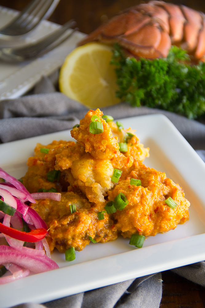 Gluten Free Lobster Bites - Lobster, lightly pan-fried succulent lobster. These gluten free bites are tossed in a spicy chili cream sau