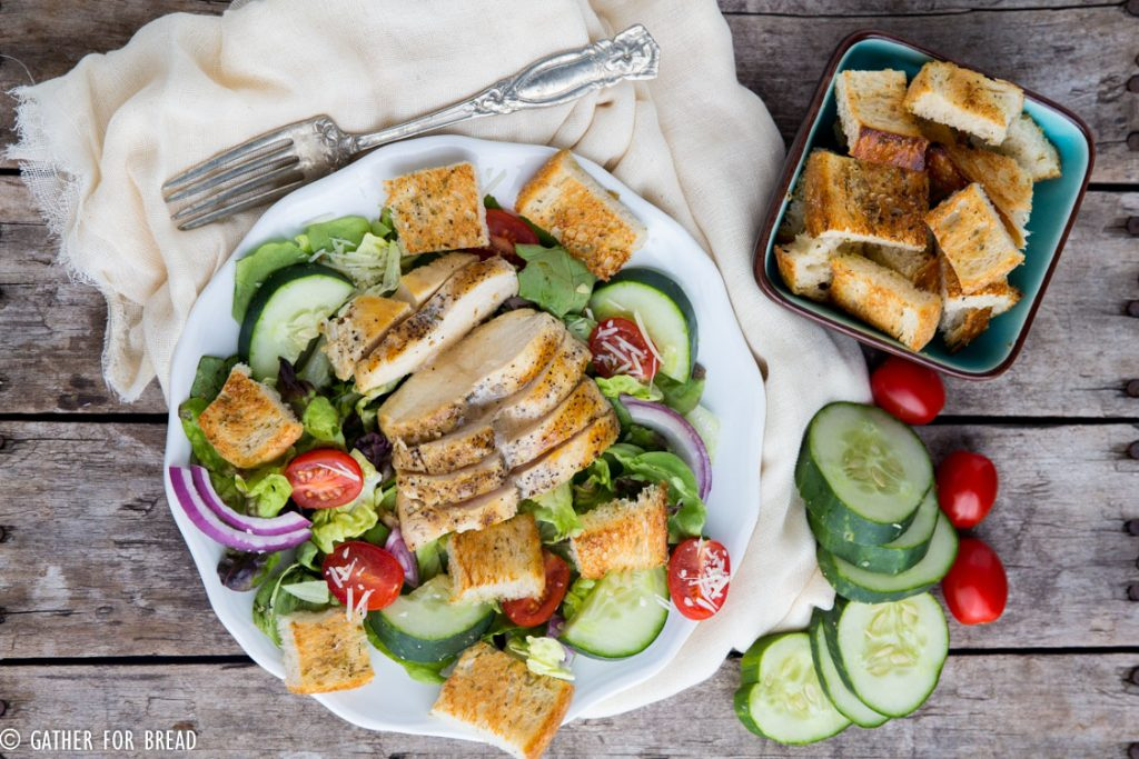 Chicken Panzanella Salad - Homemade sourdough bread cubes toasted to perfection topped on a bed of lettuces and vegetables with grilled chicken. Homemade vinaigrette, this makes the perfect lunch.