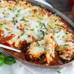 Baked Italian Meatballs- Enjoy this Easy Cheesy homemade Italian meatball casserole baked in the oven. Serve with garlic bread for a homemade meal that's simple and tasty.