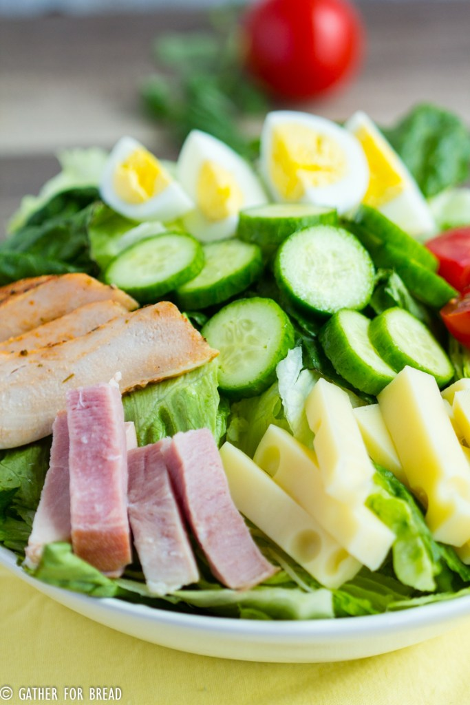 Chef's Salad Recipe - Homemade chef's salad made with Romaine lettuce, ham, turkey and chopped vegetables. Delicious ingredients for an easy salad made in minutes.