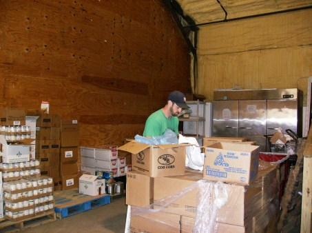 Volunteer working in the food warehouse