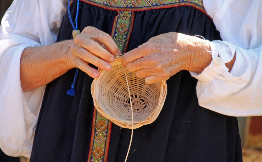 Woman_basketweaving_at_Fort_Ross_State_Historic_Park_-_Stierch.jpg