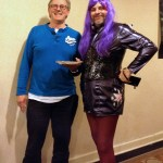 """A bemused """"Fifth Doctor"""" Peter Davison and his pizza pose with Twilight Sparkle at MystiCon 2013."""