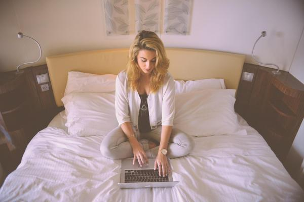 Person-woman-hotel-laptop-jpg