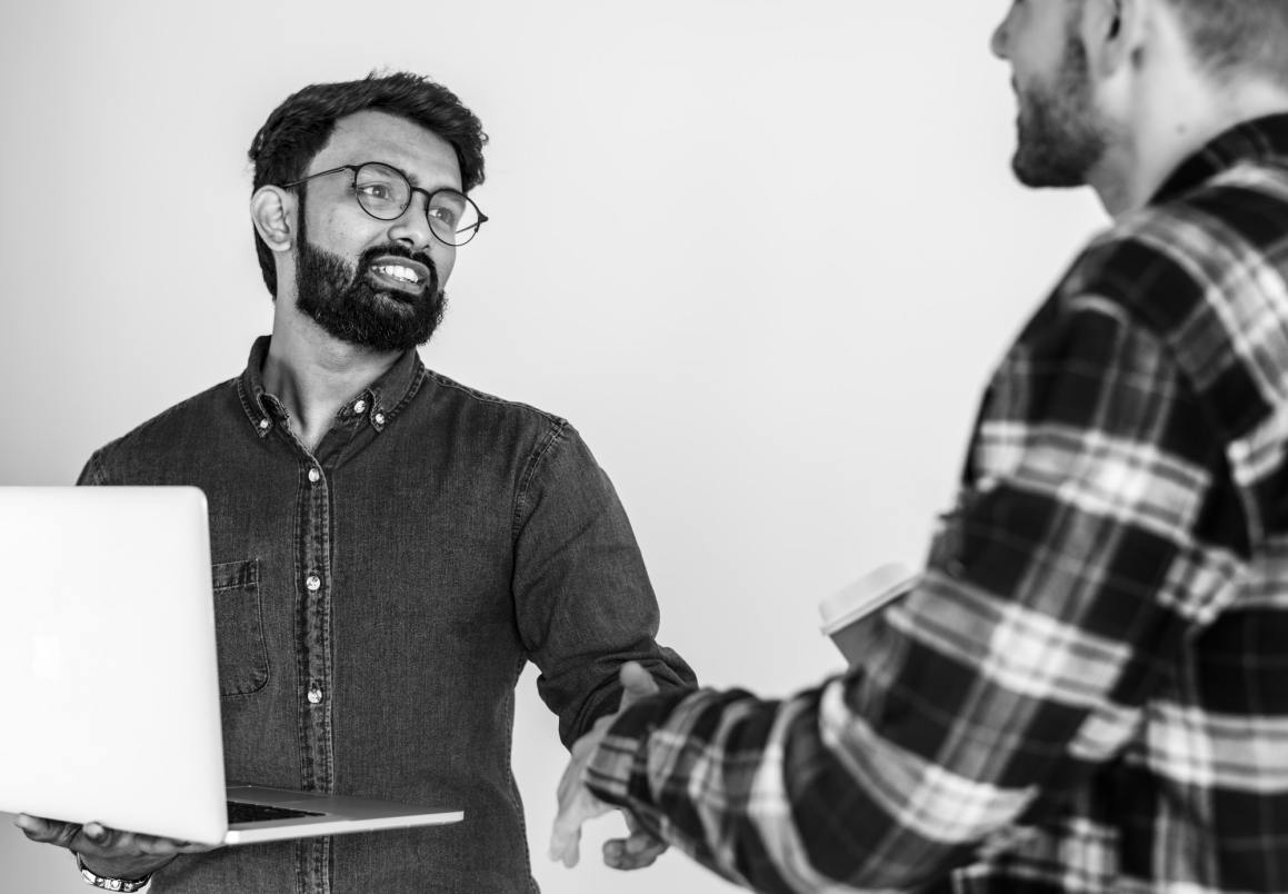 Diverse colleague men shaking hands together. Llc in india