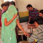 बदायूं लोकसभा क्षेत्र के गाँव महानगर में वोट डालने की प्रक्रिया से गुजरती एक महिला मतदाता।