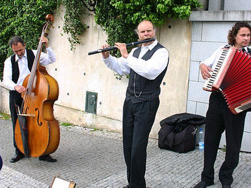 Street musicians in Prague performing a Polka
