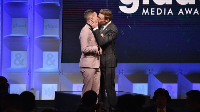 Gus Kenworthy and Adam Rippon kiss at the GLAAD Awards