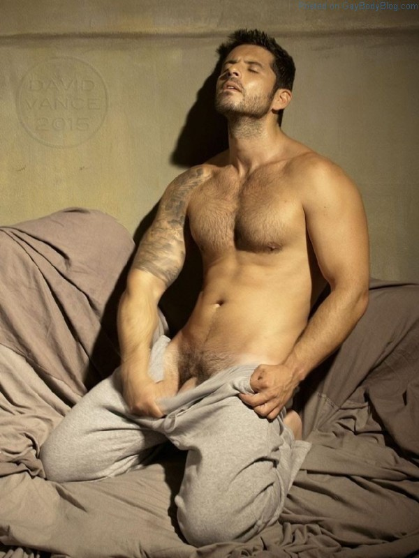Male model Diego Arnary teasing and showing an inch of his cock