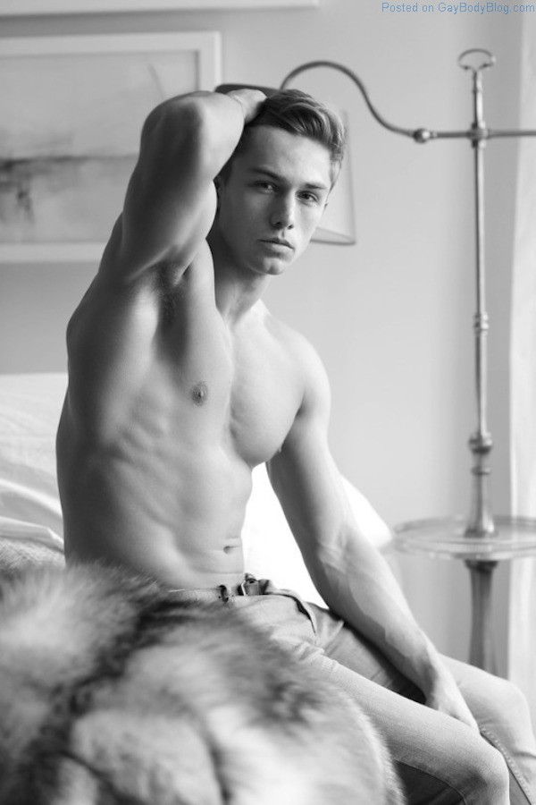 Yummy guy teasing with his body