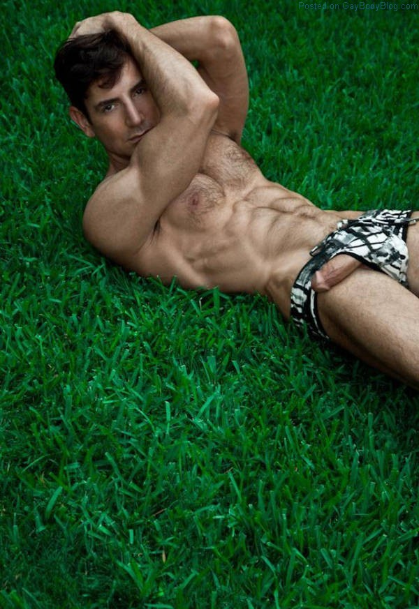 hairy jock laying on the grass with his big cock hanging out