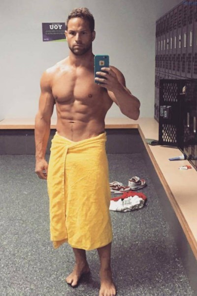 muscle man selfie in locker room towel