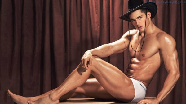 handsome male model Pietro Boselli wearing a hat and tight white underwear