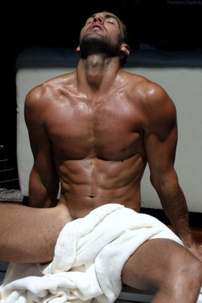 Male model Mitchell Wick wearing just a towel
