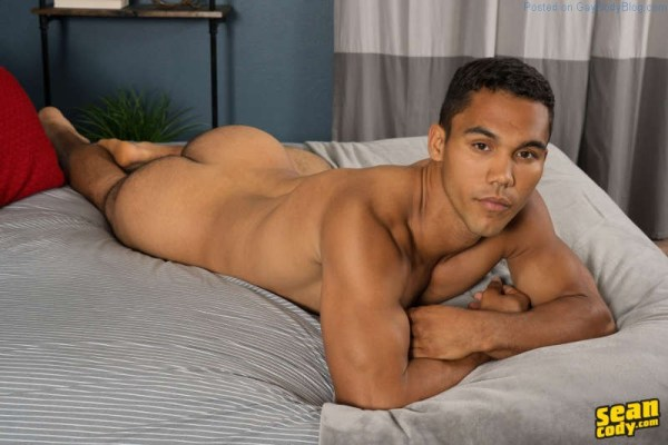 handsome bisexual jock laying on a bed showing his ass
